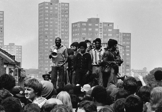 Darcus Howe (with loudhailer) addresses a crowd, 1977.