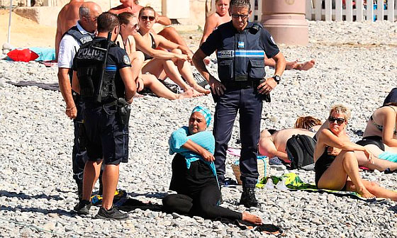French police make woman remove clothing on Nice beach following Burkini ban