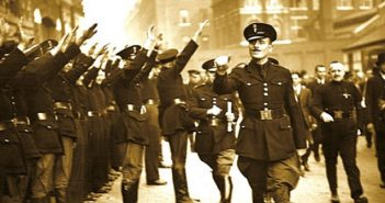Sir Oslwald  Mosley salutes his fascist Blackshirts