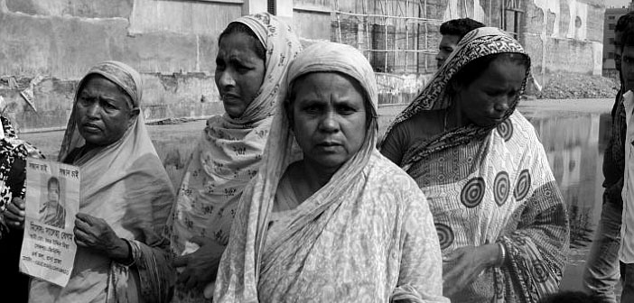 Mothers whose children died when Rana Plaza collapsed gather at site of the factory. Picture: Tansy Hoskins
